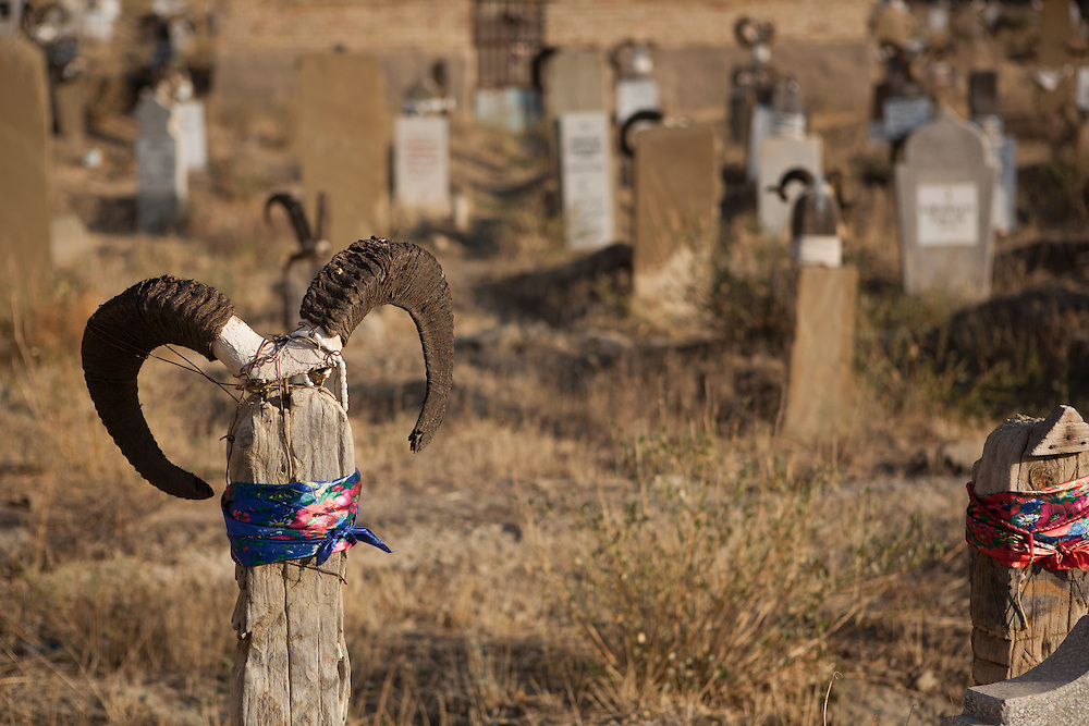 An animist-muslim tombstone with goat or sheep horns in a cemetery in Nokhur village, Turkmenistan