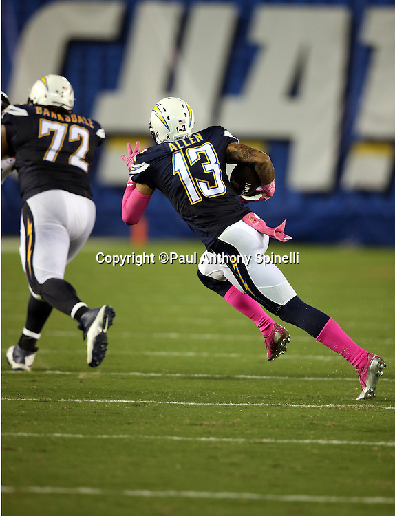 San Diego Chargers wide receiver Keenan Allen (13) follows a block by San Diego Chargers tackle Joe Barksdale (72) as he catches a third quarter pass for a gain of 10 yards and a first down during the 2015 NFL week 5 regular season football game against the Pittsburgh Steelers on Monday, Oct. 12, 2015 in San Diego. The Steelers won the game 24-20. (©Paul Anthony Spinelli)