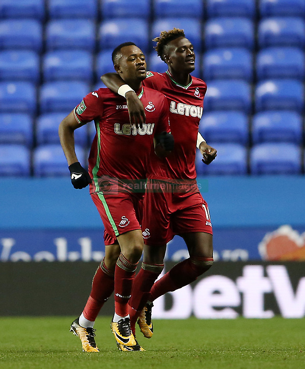 Swansea's Jordan Ayew (left) celebrates with Tammy Abraham after scoring their second goal during the Carabao Cup, third round match at the Madejski Stadium, Reading.