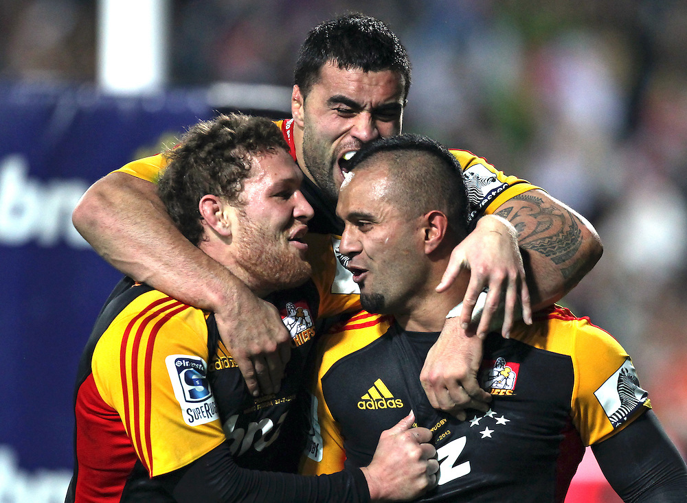Chiefs' Lelia Masaga is congratulated on scoring a try against the Crusaders by Tawera Kerr-Barlow and Chiefs' Liam Messam in a Super Rugby semi final match, Waikato Stadium, Hamilton, New Zealand, Saturday, July 27, 2013.  Credit:SNPA / David Rowland