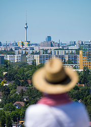 Visitor on viewing platform looking at Berlin skyline  at IFA 2017 International Garden Festival (International Garten Ausstellung) in Berlin, Germany