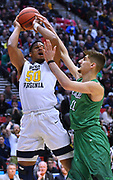 SAN DIEGO, CA - MARCH 18:  West Virginia Mountaineers forward Sagaba Konate (50) is fouled by Marshall Thundering Herd forward Ajdin Penava (11) during a second round game of the Men's NCAA Basketball Tournament at Viejas Arena in San Diego, California.  (Photo by Sam Wasson)