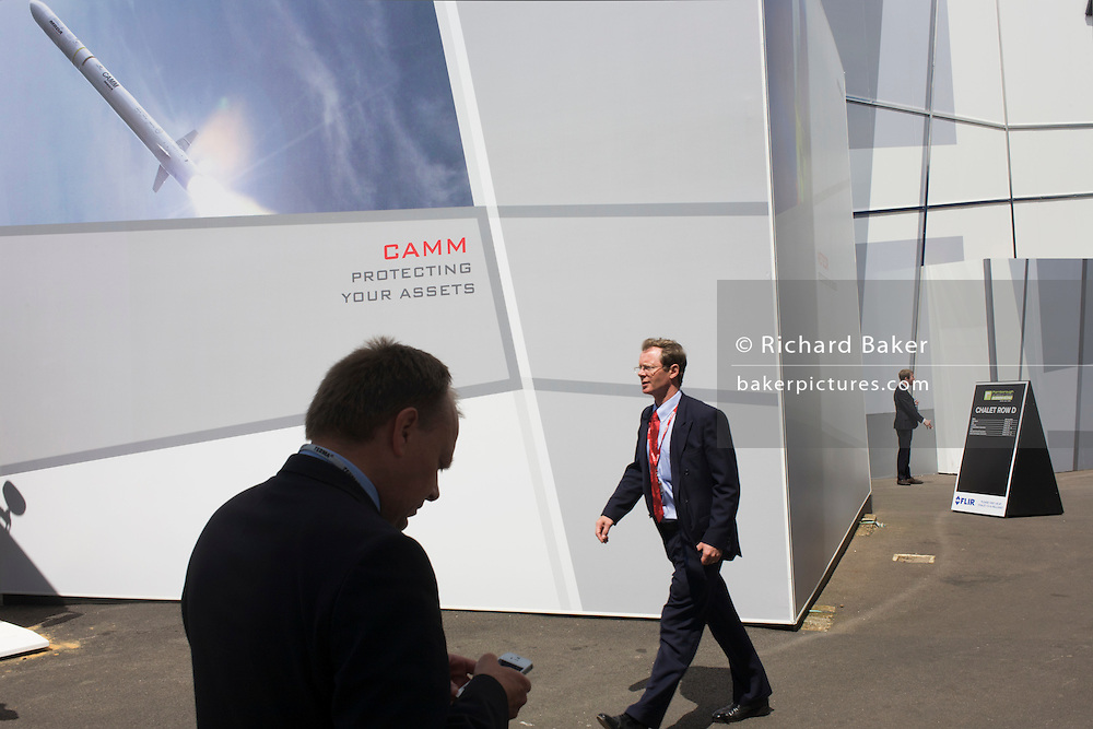 Farnborough air show delegates beneath MBDA's CAMM  missile system billboard. .