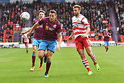 Doncaster Rovers forward Andy Williams (11) and Scunthorpe United defender Murray Wallace (5) during the EFL Sky Bet League 1 match between Doncaster Rovers and Scunthorpe United at the Keepmoat Stadium, Doncaster, England on 17 September 2017. Photo by Ian Lyall.