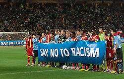 02.07.2010, Soccer City Stadium, Johannesburg, RSA, FIFA WM 2010, Viertelfinale, Uruguay (URU) vs Ghana (GHA) im Bild Players of Uruguay and Ghana against racism, EXPA Pictures © 2010, PhotoCredit: EXPA/ Sportida/ Vid Ponikvar, ATTENTION! Slovenia OUT