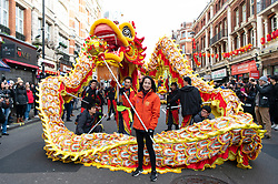 © Licensed to London News Pictures. 26/01/2020. London, UK. Performers perform Soho's Chinatown during the Chinese New Year celebrations for the Year of the Rats. Hundreds of thousands of Londoners and tourists have descended on the capital to enjoy the festivities which is the biggest such celebration outside Asia. Photo credit: Ray Tang/LNP