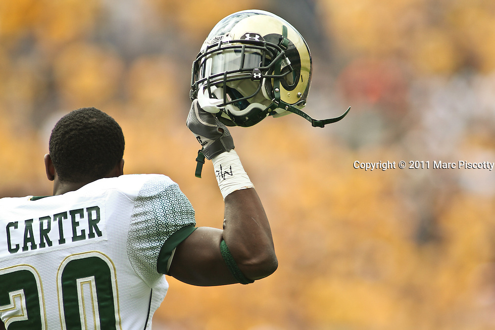 SHOT 9/17/11 11:39:36 AM - Colorado State's Raymond Carter #20 gets fired up right after the national anthem during their Mile High Showdown game against Colorado at Sports Authority Field at Mile High Stadium. Colorado won the in-state rivalry game 28-14. (Photo by Marc Piscotty /  © 2011)
