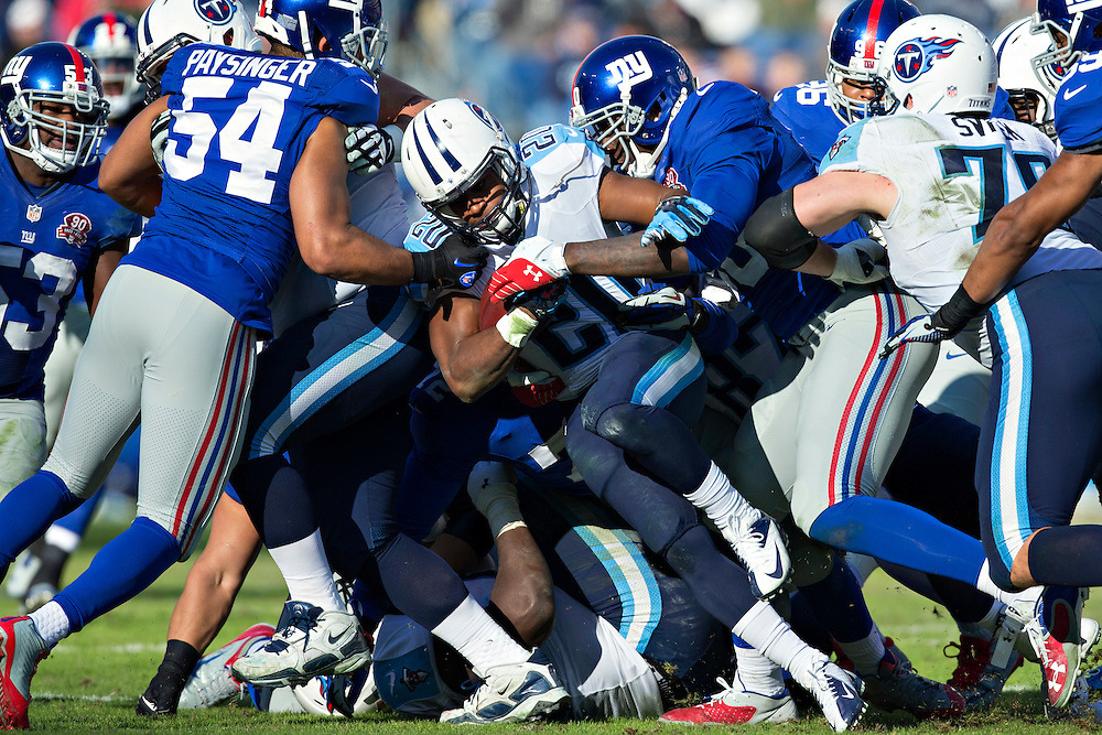 NASHVILLE, TN - DECEMBER 7:  Bishop Sankey #20 of the Tennessee Titans runs the ball and is tackled by Jason Pierre-Paul #90 of the New York Giants at LP Field on December 7, 2014 in Nashville, Tennessee.  The Giants defeated the Titans 36-7.  (Photo by Wesley Hitt/Getty Images) *** Local Caption *** Bishop Sankey; Jason Pierre-Paul