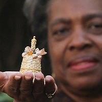 Louise Evans poses for a portrait with her favorite bell at her home Sunday December 14, 2014 in Wilmington, N.C. Evans has a collection of more than 600 bells. (Jason A. Frizzelle)