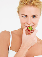 Young Woman in underwear Eating Strawberry portrait