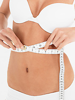 Young Woman in underwear Measuring own Waist front view mid section