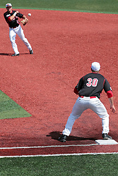 26 April 2014:   2nd baseman Joe Kelch throws the ball to first baseman Brian Rodemoyer putting out Dyllin Mucha during an NCAA Division 1 Missouri Valley Conference (MVC) Baseball game between the Southern Illinois Salukis and the Illinois State Redbirds in Duffy Bass Field, Normal IL