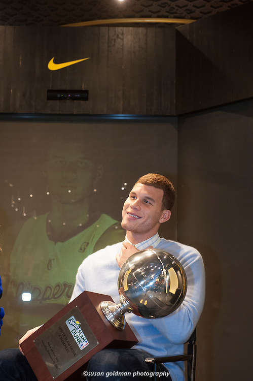 Los Angeles Clipper's basketball player Blake Griffin holds the slam dunk trophy after winning the event at the Nike NBA All-Star event in Los Angeles. Photo/Nike, Susan Goldman.