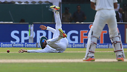 August 4, 2017 - Colombo, Sri Lanka - Sri Lankan cricket captain Dinesh Chandimal stops a ball hit by Indian cricketer Ravindra Jadeja during the 2nd Day's play in the 2nd Test match between Sri Lanka and India at the SSC international cricket stadium at the capital city of Colombo, Sri Lanka on Friday 04 August 2017. (Credit Image: © Tharaka Basnayaka/NurPhoto via ZUMA Press)