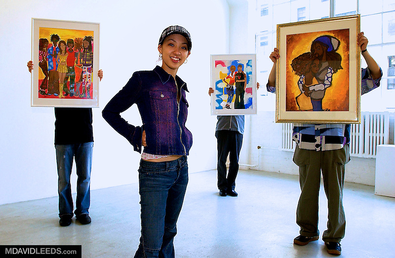 NEW YORK, NY - AUGUST 7:  A portrait of artist Hitoe Arakaki, of the pop band Speed, poses with a few of her paintings prior to an exhibit of her work at the Caelum Gallery in New York, New York.  (Photo By M. David Leeds)..