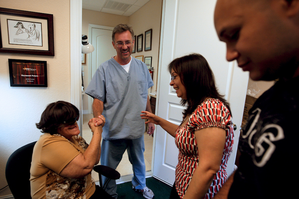 """Amalia Mendoza, left, greets David Trainer, left, a maxillo-facial prosthetist in Naples, Fla. after a day of work making a new face for Mendoza. Trainer, who makes facial prosthetics said Mendoza's case was more extensive than any he has worked on. """"What's running through my head is, what am I going to do, how am I going to tackle the problem that I'm faced?"""" Greg Kahn/Staff"""