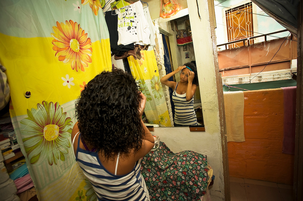 15-year-old mother, Yanaifre Acevedo, does her hair and make-up in a slum in Caracas, Venezuela.