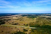Nederland, Gelderland, Gemeente Ede, 09-06-2016; Nationaal Park De Hoge Veluwe, Oud-Reemsterzand. Hardewijkerweg met ecoduct. In de achtergrond zijn delen afgegraven met als doel de stuifzandvegetatie te herstellen <br /> Bij deze natuurontwikkeling zijn door toeval vondsten gedaan die wijzen op een ondergestoven middeleeuwse nederzetting.<br /> Oud-Reemster sand. Large areas have been excavated in order to restore the vegetation of shifting sands landscape.<br /> luchtfoto (toeslag op standard tarieven);<br /> aerial photo (additional fee required);<br /> copyright foto/photo Siebe Swart