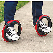 Could you master the skateboard WITHOUT a board? $100 sidewinding skates put your feet inside the wheels<br /> <br /> If rollerskates are too retro and skateboarding too restrictive, there's a new hydrid vehicle to master.<br /> <br /> The Post Modern Skateboard is a cross between a skateboard and inline skates, and allows riders to perform effortless-looking spins... with a lot of practice.<br /> <br /> It comprises two 10-inch wheels, which riders position their feet inside, instead of balancing on a conventional board.<br /> <br /> The wheels can be joined together with a pole, to make the experience more like skateboarding, or kept separate, to be used more like in-line skates.<br /> <br /> 'The annular skates… are propelled by leaning side to side, allowing you to skateboard without having to push off the ground,' according to the entry in the Hammacher Schlemmer catalogue.<br /> <br /> 'Riders simply place their feet on the two platforms and lean side-to-side to rotate the rubber wheels around the feet, propelling riders forward in a serpentine motion similar to longboard skateboarding.'<br /> <br /> When the wheels are connected by a metal pole, the toy is most similar to a casterboard, which is a skateboard with two wheels that can travel in any direction.<br /> <br /> 'The included extendable rod can be connected to both wheels, providing stability to novices and hastening the learning period,' the catalogue says.<br /> <br /> When the wheels are not connected and work more like inline skates, 'riders can easily perform 720° spins and turn on a dime'.<br /> <br /> Riders stop by placing their toes on the ground.<br /> <br /> The wheels of the 'board' measure 10 inches in diameter (25cm) so that it can be used on uneven road surfaces and grass.<br /> <br /> It costs $100 (£67) and is designed to be used by ages eight and upwards.<br /> ©Hammacher Schlemmer/Exclusivepix media