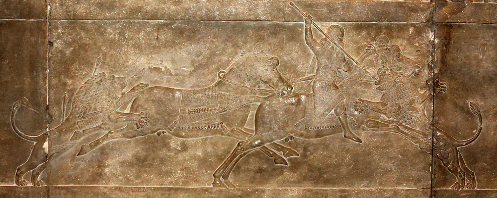 Lion hunt on horseback. Wall fragment depicting King Ashurbanipal and his attendants hunting lions. Assyrian, circa 645-635 BC. From the North Palace in Nineveh.