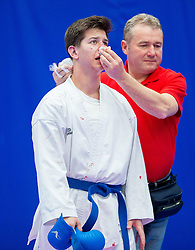 Injured Athlete of Hungary (blue) during of Kumite Team male at Day Two of Karate 1 World Cup - Thermana Slovenia Lasko 2014 tournament, on March 16, 2014 in Arena Tri Lilije, Lasko, Slovenia.Photo by Vid Ponikvar / Sportida
