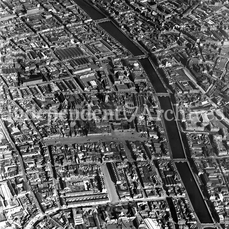A407 Smithfield.   26/11/54. (Part of the Independent Newspapers Ireland/NLI collection.)<br /> <br /> <br /> These aerial views of Ireland from the Morgan Collection were taken during the mid-1950's, comprising medium and low altitude black-and-white birds-eye views of places and events, many of which were commissioned by clients. From 1951 to 1958 a different aerial picture was published each Friday in the Irish Independent in a series called, 'Views from the Air'.The photographer was Alexander 'Monkey' Campbell Morgan (1919-1958). Born in London and part of the Royal Artillery Air Corps, on leaving the army he started Aerophotos in Ireland. He was killed when, on business, his plane crashed flying from Shannon.