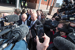 © Licensed to London News Pictures . 02/05/2013 . Preston , UK . Broadcaster STUART HALL leaves Preston Crown Court this morning (Thursday 2nd May) surrounded by media after a pre trial hearing . Hall has admitted to a series of historic sexual assaults . Photo credit : Joel Goodman/LNP