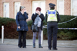 © Licensed to London News Pictures. 03/02/2016. Allerton Bywater UK. Two women cry at the scene on Beeston way were a police investigation is still underway after the bodies of two children & a woman were found at the property. Photo credit: Andrew McCaren/LNP