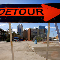 TAMPA, FL -- March 11, 2010 -- A detour sign is posted near the site of a proposed Tampa-Orlando high speed rail project (at right) near the Marion Transit Center in Tampa, Fla., on Wednesday, March 11, 2010. The proposed Tampa-Orlando high speed rail project will connect Orlando and Tampa but the questions remains how much it will be used and how long it will take to get from places cement to sand after riding it.