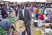 A Kenyan street preacher preaches to the market stallholders and shoppers in the Makongeni market, Thika, Kenya. The market work closely with Afcic, Action for children in conflict, and are trying to encourage the kids to go to school. The manager has banned children from working in the market during school hours.