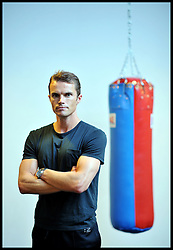 Portrait of Celebrity Personal Trainer Matt Roberts training someone in his Gym in West London, Tuesday August 9, 2011. Matt trains the Prime Minister David Cameron amongst other celebrities.  Photo By Andrew Parsons