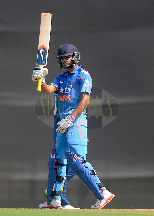 Manish Pandey of India acknowledges teammates after scoring a half century during the practice match between India A and Sri Lanka held at the CCI Stadium, Mumbai,  India on the 30th October 2014<br /> <br /> Photo by:  Pal Pillai/ Sportzpics/ BCCI
