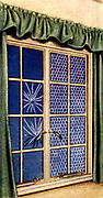 Air Raid Precautions: Set of 50 cards issued by WD & H0 Wills, Britain 1938, in preparation for the anticipated coming of World War II. Window Protection Against Blast: Left, Strengthened glass; Right, Non-flammable transparent celluloid with internal wire netting.