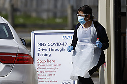 © Licensed to London News Pictures. 28/03/2020. Chessington, UK. A drive through virus testing centre for NHS staff has opened in the car park of Chessington World of Adventures. Death rates from the spread of coronavirus continue to climb. Both the Prime Minister Boris Johnson and Health Secretary Matt Hancock have tested positive for the virus and are now self isolating. Photo credit: Peter Macdiarmid/LNP