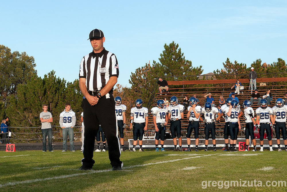 Official Tyler Simmons steps back after escorting the LaGrande team captains to mid field for the coin toss on September 20, 2013 at Frank Hawley Stadium in Vale, Oregon.