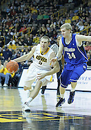 December 17, 2011: Iowa Hawkeyes guard Matt Gatens (5) drives to the basket as Drake Bulldogs forward Ben Simons (34) defends during the the NCAA basketball game between the Drake Bulldogs and the Iowa Hawkeyes at Carver-Hawkeye Arena in Iowa City, Iowa on Saturday, December 17, 2011. Iowa defeated Drake 82-68.