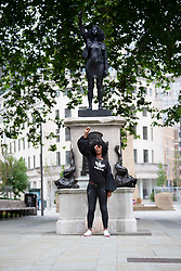 © Licensed to London News Pictures.15/07/2020. Bristol, UK. A statue of BLM protester Jen Reid (pictured), made by Mark Quinn is installed in Bristol on the empty plinth where the statue of 17th century slave trader and Bristol philanthropist Edward Colston used to stand. . Photo credit: Marcin Nowak/LNP