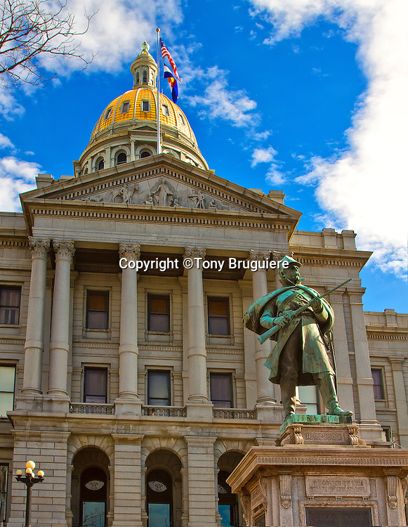 The Colorado Capitol building, located in downtown Denver, pays tribute to the gold rush days with its plating of pure gold from the the legendary mines of the Rocky Mountains. The bronze statute pays tribute to the soldiers of the War Between the States.