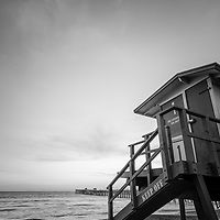 San Clemente lifeguard tower one and San Clemente Pier black and white photo. San Clemente is a popular beach city in Orange County California in the United States of America. Photo is high resolution and Copyright ⓒ 2017 Paul Velgos with All Rights Reserved.