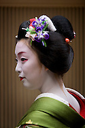 Miehina, a 20 year old maiko ( an apprentice geisha) from the Miyagawacho district of Kyoto,  with the traditional maiko hair ornament known as a 'hanakanzashi' which changes each month/season to show the flower of the season (in this case a 'ayame' iris flower), Japan, Sunday, May 18th 2008.