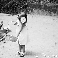 A flower girl at a wedding in Parc de Laberint, Barcelona, Catalunya, Spain.