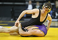 December 8, 2011: Iowa Hawkeyes Derek St. John tries to release the grip of Northern Iowa Panthers David Bonin in the 157 pound bout of the NCAA wrestling dual between the Northern Iowa Panthers and the Iowa Hawkeyes at Carver-Hawkeye Arena in Iowa CIty, Iowa on Thursday, December 8, 2011. St. John defeated Bonin 3-1and Iowa defeated Northern Iowa 38-4.