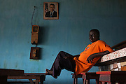 TOGO - 12-11-30   - A restaurateur waits for customers in Agbandi, Togo, on November 30, 2012.   Photo by Daniel Hayduk