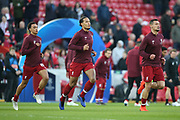 Liverpool defender Trent Alexander-Arnold (66), Liverpool defender Virgil van Dijk (4) and Liverpool defender Dejan Lovren (6) warming up during the Champions League Quarter-Final Leg 1 of 2 match between Liverpool and FC Porto at Anfield, Liverpool, England on 9 April 2019.