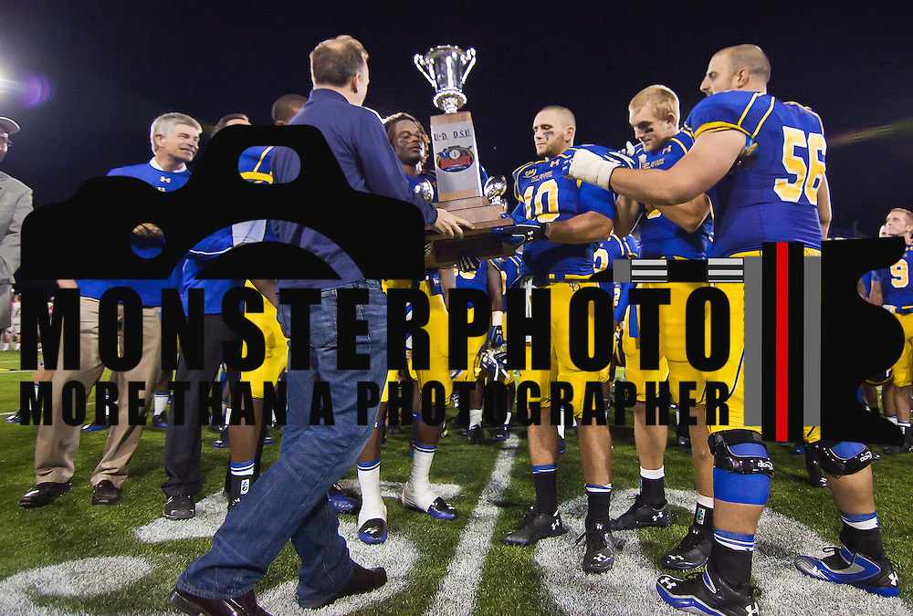 The Delaware football team receives the first state cup trophy from Delaware Governor Jack Markell after defeating Delaware State 45-0 Saturday Sept. 17, 2011 in Newark DE.<br /> <br /> Delaware defeated Delaware State 45-0 in front of 18,011 fans at Delaware Stadium Saturday Sept. 17, 2011 in Newark DE.<br /> <br /> Delaware will return home Sept. 24, 2011 for a Colonial Athletic Association showdown with Old Dominion at 12:pm at Delaware Stadium.<br /> <br /> Delaware State will hit the road for two game at Orangeburg South Carolina and at Tallahassee, Florida before returning home Saturday, October. 8, 2011 to face Norfolk State.<br /> <br /> (Monsterphoto/Saquan Stimpson)