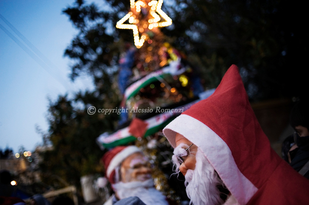 .A Palestinian Santa Claus outside one of the disputed houses occupied by Israeli settlers in the Arab Sheikh Jarrah neighborhood in East Jerusalem, on December 23, 2009..© ALESSIO ROMENZI