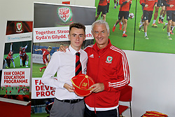 NEWPORT, WALES - Sunday, May 28, 2017: Conor Govdsworthy receives a cap from Elite Performance Director Ian Rush for participation during day three of the Football Association of Wales' National Coaches Conference 2017 at Dragon Park. (Pic by Mark Roberts/Propaganda)