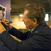Governor Kasich signs a photograph outside the Billy Goat Tavern. Ohio Governor and Republican presidential candidate John Kasich speaks during a short campaign stop at the Billy Goat Tavern in Chicago on Nov. 9, 2015.  <br /> Photography by Jose More