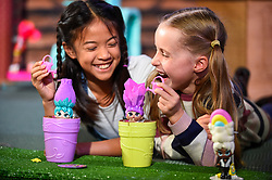 "© Licensed to London News Pictures. 13/11/2019. LONDON, UK. (L to R) Fiona (aged 10) and Gwen (aged 8) play with Blume Dolls by Skyrocket at the preview of ""DreamToys"", the official toys and games Christmas Preview, held at St Mary's Church in Marylebone.  Recognised as the countdown to Christmas, the Toy Retailer's Association, an independent panel of leading UK toy retailers, have selected the definitive and most authoritative list of which toys will be the hottest property this Christmas.  Photo credit: Stephen Chung/LNP"