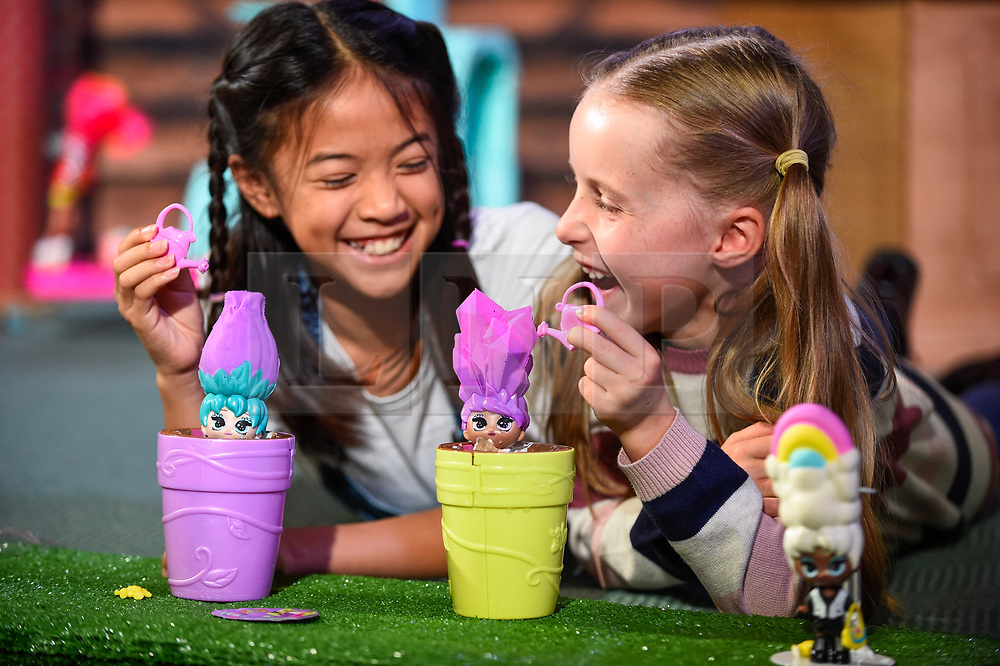 """© Licensed to London News Pictures. 13/11/2019. LONDON, UK. (L to R) Fiona (aged 10) and Gwen (aged 8) play with Blume Dolls by Skyrocket at the preview of """"DreamToys"""", the official toys and games Christmas Preview, held at St Mary's Church in Marylebone.  Recognised as the countdown to Christmas, the Toy Retailer's Association, an independent panel of leading UK toy retailers, have selected the definitive and most authoritative list of which toys will be the hottest property this Christmas.  Photo credit: Stephen Chung/LNP"""